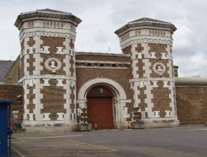 Transgender inmate 'threw cup of urine in prison officer's face'