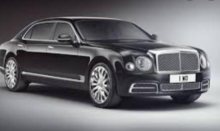 Bentley thief 'made gun sign at cop'