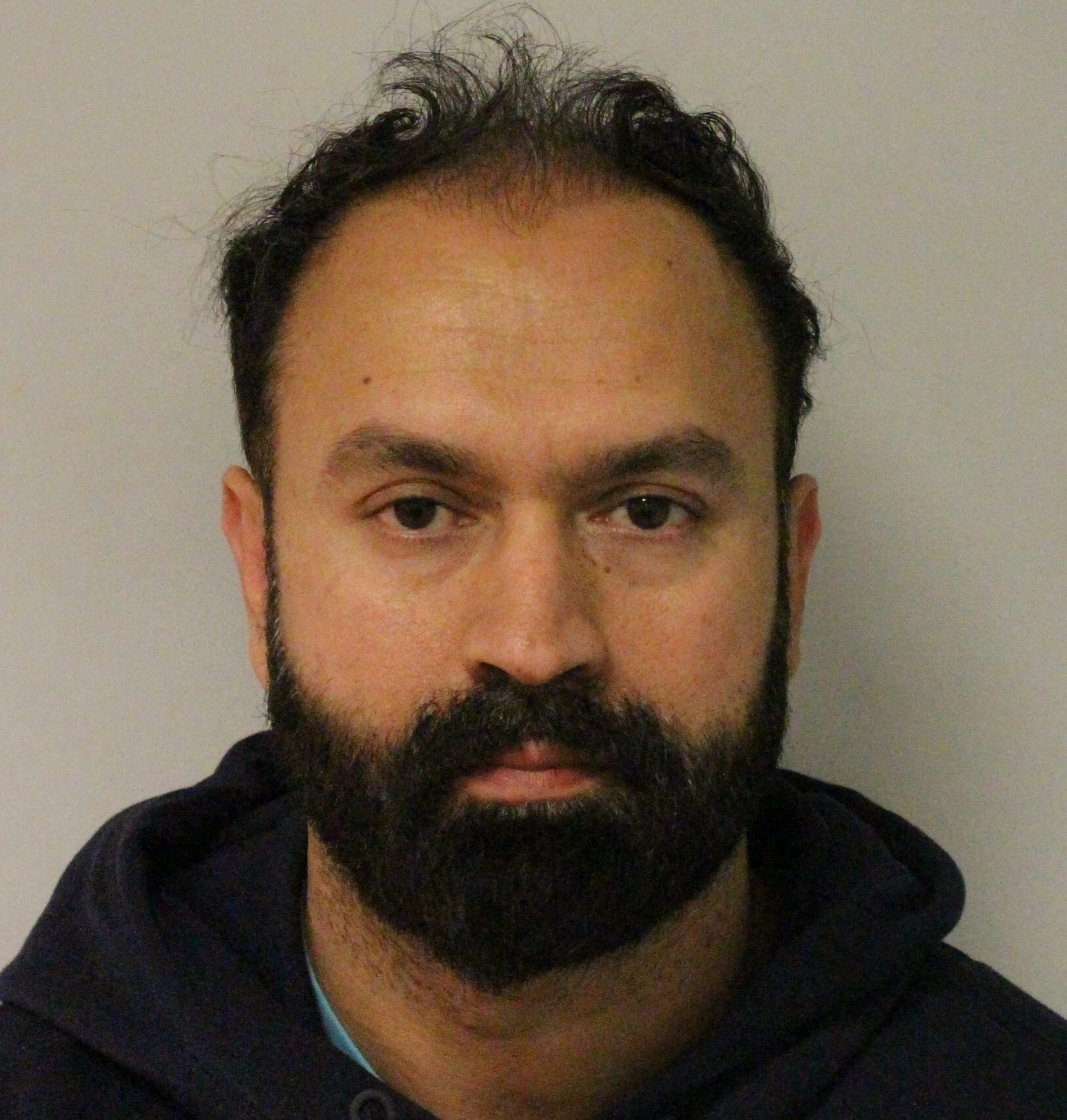 Creepy cop spared jail